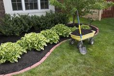 Inexpensive Landscaping Ideas --- really great ideas from lots of resources (from plants at a yard sale to construction sites and more)