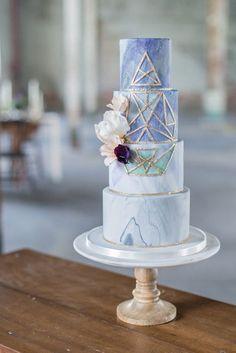 geometric wedding cake - photo by Laura Kelly Photography http://ruffledblog.com/industrial-bohemian-geode-wedding