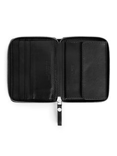 """<p style=""""text-align: justify;"""">A small wallet crafted from premium, chrome free tanned leather. A unisex style in a practical pocket size with zip closure."""