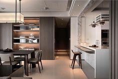 Seguindo a tendência de ambientes integrados. O balcão da cozinha é utilizado para as refeições mais rápidas. Destaca-se aqui a bancada em nano glass e os pendentes sobre a mesma.