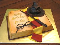 For a harry potter fan.  Book sculpted from a 9x13 sheet cake.  Sorting hat is cake.  Yellow cake with canned choc  frosting (as requested by the birthday girl, lol) and covered in fondant.  Design credit goes to Rebeccah Sutterby of Sugar Creations.