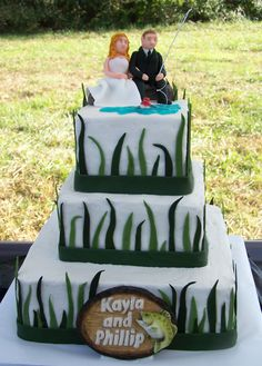 fishing themed wedding cake  with all custom fondant bride and groom and plaque