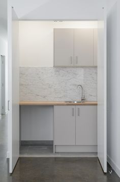 Another DIY laundry fit for a small apartment. Create a seamless flow through your kitchen and laundry with kaboodle cabinets, benchtops and splashbacks!