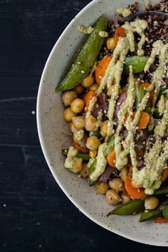 This looks really awesome: Roasted Vegetable + Chickpea Bowl with Cilantro Cashew Cream