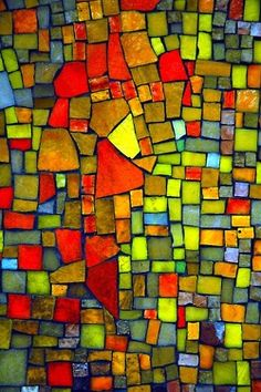 Mosaic. This could be done with black paint for the background and paper for the shapes.
