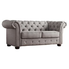 Curl up with a plush throw and your favorite mystery novel in this Chesterfield-style loveseat, perfect for entertaining your book club or catching up on sew...