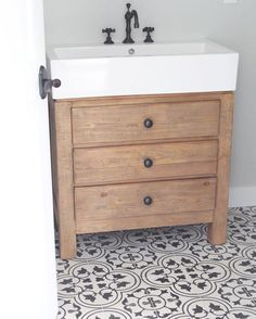 The classic Bouquet III pattern in black and white looks right at home with this natural wood vanity.