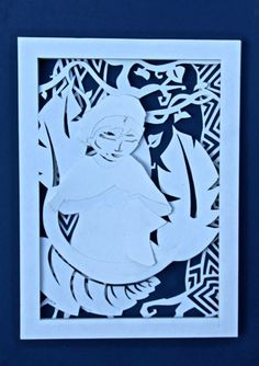 Layered paper cut out of Kuna Indigenous Woman of Panama.