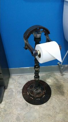 Cam toilet paper stand. We build custom car part furniture and accessories.  On Facebook as Bent Wrench salvage designs