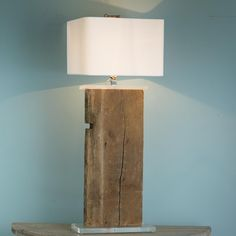 Antique 1828 Barnwood Beam Table Lamp  Reclaimed lighting is in vogue! Take an antique warehouse beam up a notch with clear acrylic base and smart square white linen shade. Oversized and sophisticated, this massive lamp introduces an organic and modern juxtaposition. 3-way 100 watts. (44Hx16W)