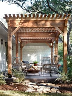 This pergola played an important role in adding to the home's new style. Building it on the front of the home added an interesting element to the exterior by drawing out the front elevation and helping it feel more 3 dimensional. It also gave the family a comfortable outdoor gathering area and helped to achieve the indoor/outdoor feeling you'd want in a coastal style house.