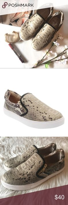 "VINCE CAMUTO JZIP- SNAKE EMBOSSED ZIP SNEAKER 8 Vince Camuto slip-on's in great, used condition! Super cute! & Sold exclusively at VinceCamuto.com and Vince Camuto retail locations! 👟  Grey/ tan/ cream/ Snakeskin print. ""Appropriately named for neat zipper details parallel to the tongue, the Jzip is leading the sneaker revolution. A year-round alternative to an espadrille, this slip-on shoe rocks a causal cool design, gifting you comfort and laidback style. Man-made upper, leather lining…"