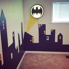 Gotham City Skyline that I painted for my son's Batman room. Found the Bat light at Hobby Lobby!