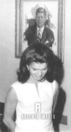 Mrs. J.F. Kennedy stands beneath a portrait of her late husband after the first meeting of the Advisory Committee for Institute of Politics ended 10/17 at Harvard University. Harvard renamed its Graduate School of Public Administration the John Fitzgerald Kennedy School of Government, and created within he school an Institute of Politics. RIP http://en.wikipedia.org/wiki/Jacqueline_Kennedy_Onassis http://en.wikipedia.org/wiki/John_F._Kennedy