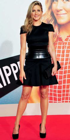 Jennifer Aniston stuck to what she knows best: A classic LBD. This time, she spiced things up, accessorizing her Alexander McQueen dress with leather corset belt, a Givenchy clutch and black pumps.