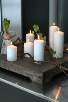 .A simple and well balanced rustic candle display.  Notice the use of the classic grouping of 3 candles.  It just works.  Multiples of three, and in different sizes.  We have the pillar candles for home decor or a big event. The most extensive color selection available.  www.BeverlyHillsCandle.com