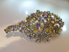 AB Brooch Gold Finish - Wow!  This AB brooch is so pretty I had to keep it in my collection for a little while.   All faceted glass rhinestones with AB Finish. Along the st... #vintage #jewelry #sterling #925 #rings #vjt