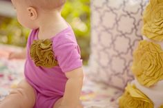 I really want a sewing machine to make adorable onesies like this!