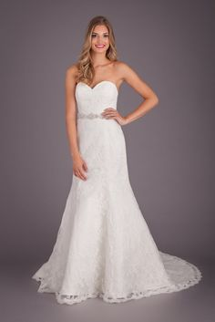 From the fit to the glamour, this is a fitted lace bridal gown you'll fall for! | Featured Style: A Lace Fit and Flare Wedding Dress