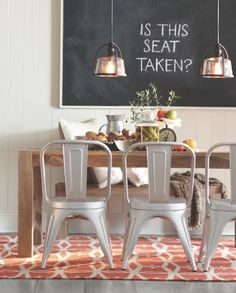 Fact: mixing materials like wood and metal helps to uncramp a small dining space.