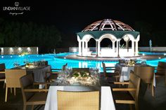 Dine by the freeform swimming pool, illuminated by the emblematic Dome!