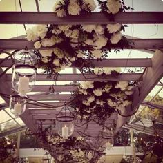 Wedding aisle white flowers candles above