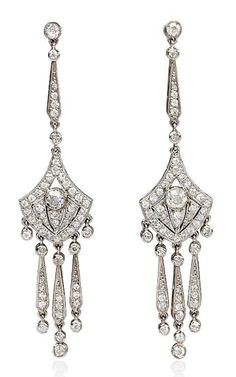 A pair of Art Deco diamond earrings with shield-shaped centers and pendant drops, in platinum. Atw. 2.00 cts. J-K, VS2-SI2. Circa: 1930