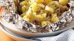 Chives, garlic salt and Parmesan give great taste to grilled potatoes that are ready to eat in 30 minutes!
