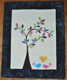 I found this beautiful quilt that I want to incorporate into my babies nursery