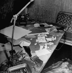 Office: Burned and scattered papers on desk inside Adolf Hitler's command bunker where he and his mistress Eva Braun were said to have committed suicide