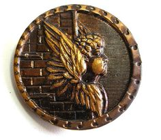 "Large brass Victorian button. ""Guardian Angel"""