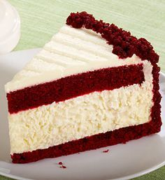 Red Velvet Cheesecake - It's kind of the most amazing thing ever a red velvet layer-cake with a layers of cheesecake mixed in topped with cream cheese icing.