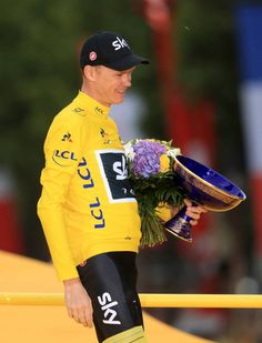 Team Sky's Chris Froome celebrates with his trophy after stage 21 of the Tour de France in Paris France