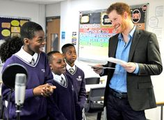 Britain's Prince Harry speaks to pupils at a lyrical writing class during a visit to the Full Effect and Coach Core programmes, two projects supported by The Royal Foundation that work to improve opportunities for young people, at Nottingham Academy, Nottingham, England, Wednesday, Feb. 1, 2017.