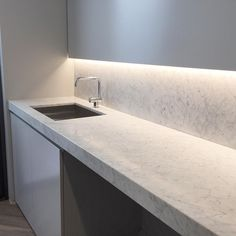 euromarbleProviding finishing touches on a spectacular project.Carrara marble laundry bench and splash back. Splashback, Laundry In Bathroom, Carrara Marble, Kitchen Inspiration, Style Ideas, Terrace, Kitchens, Sink, Bench