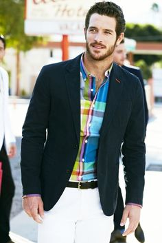 Men's ready-to-wear clothing comes in all different designs and styles. Trends for menswear fashion are defined by the style, attitude and fit. This modern styled coat takes styles from the traditional design and brings them into today's time. The navy blazer paired with the spring colored plaid shirt and white pants are an example of fashion at its finest.