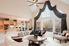Wonderfully open, and the window...  just don't like the curved couch.