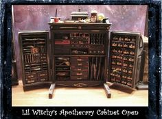 A Magnificent Cabinet for your scale Witch or Wizards scene. The Wooden Cabinet is hinged to open and filled with 58 Tiny Drawers .