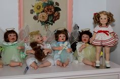 Some dolls from my collection.  The sitting angels are Ashton Drake and about 20 years old. The picture behind them came from my mother in law's house and is quite old.  Shirley temple is older than the Ashton Drake dolls and was given to me by my daughter Toni.