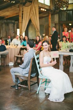 The quickest way to get guests laughing? A game that tests how well the bride and groom knoweach other's quirks. All this requires is a list of prepped questions and signs with both your names. Simply raise the name that best fits the question—just get ready to agree to disagree on who does the dishes more.