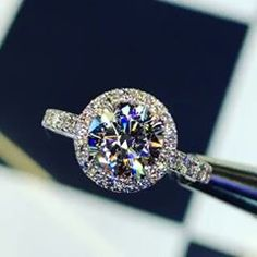 Dazzling Kate Moissanite Ring SKU: featuring round forever one moissanite with diamond micro pave setting. Art Deco Jewelry, Fine Jewelry, Jewelry Design, Jewelry Rings, Jewellery, Wedding Jewelry, Wedding Rings, Wedding Stuff, Gold Diamond Watches