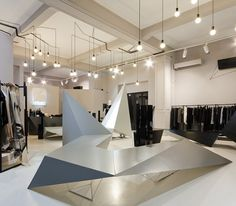 SquareONE projected the interior for a shop in Bucharest named ENTRANCE. Black electrical wires as forest / ceiling decoration. Shoe Store Design, Retail Store Design, Store Plan, Monochrome Interior, Retail Concepts, Retail Interior, Interior Design Inspiration, Work Inspiration, Ceiling Decor