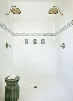 Double shower heads + all white tile.... via COCOCOZY: SEE THIS HOUSE: DREAMY RUSTIC RETREAT!