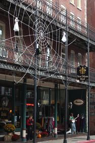 Gina Galina crocheted a spiderweb and ghosts for New Orleans Hotel & Spa. The spiderweb is about two stories high and completely covers the hotel's storefront.