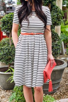 This black and white striped Amelia dress by Lularoe is stretchy but so cute with it's short sleeves, pleats, pockets, and zipper up the back! Become a Lularoe business owner today. Check out @lulagirlsblog