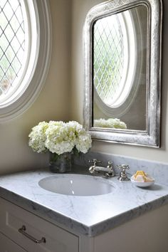 butter yellow walls white single bathroom vanity white carrara marble top Layla Grayce Eloquence Louis Philippe Silver Mirror