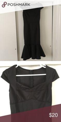Black peplum dress! Beautiful new unworn black midi heart shaped neck dress with cap sleeves and peplum ruffle hem! Dresses Midi