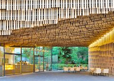 This organic cedar facade creates a soft, natural exterior that appears to be alive.