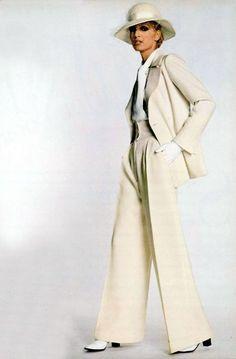 Model wearing a suit by Yves Saint Laurent for L'officiel magazine, 1970.