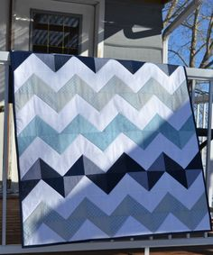 blue grey navy baby quilt by Magpie Quilts. Want one to match your nursery? email magpiequilts(at)gmail(dot)com